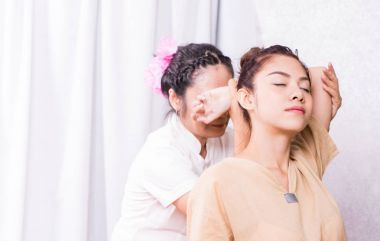 Therapist is stretching arm of a women in Thai massage course