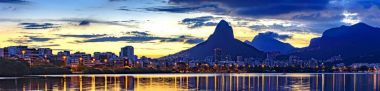 Panoramic image of the first summer sunset of the year 2018 seen from the lagoon Rodrigo de Freitas with the buildings of the city of Rio de Janeiro, Two Brothers hill and Gavea stone