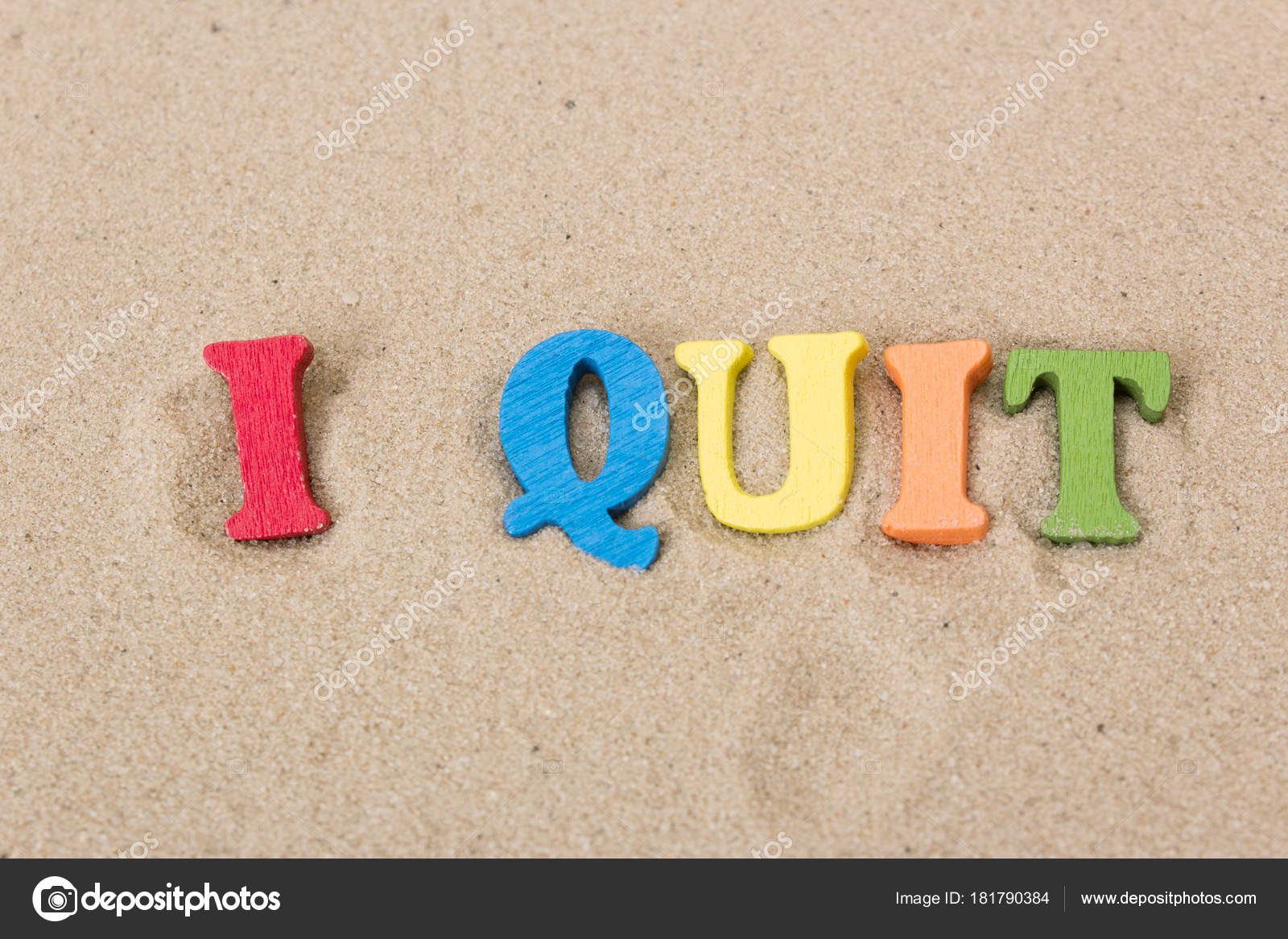 Word I Quit of colored wooden letters on sandy beach — Stock Photo