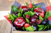 beautiful bouquet of berries and fruits (plum, apple, strawberry, currant)