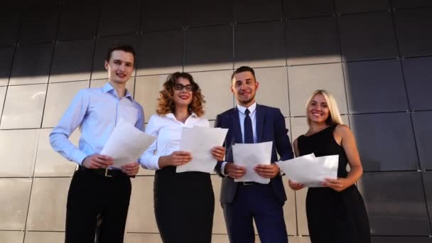 Happy Business Team Throw up Paper Documents Near Center Office