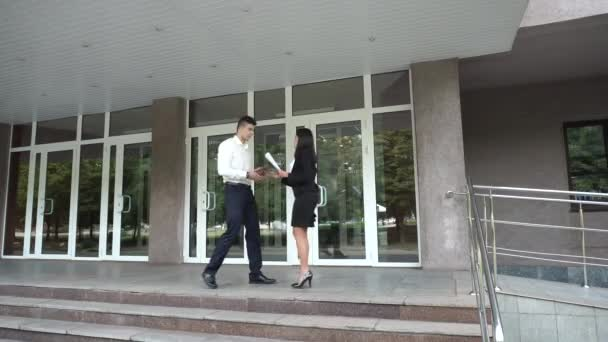 Young Beautiful Asian Business Woman Female and Caucasian Male Meet Walk on Office Building Stairs