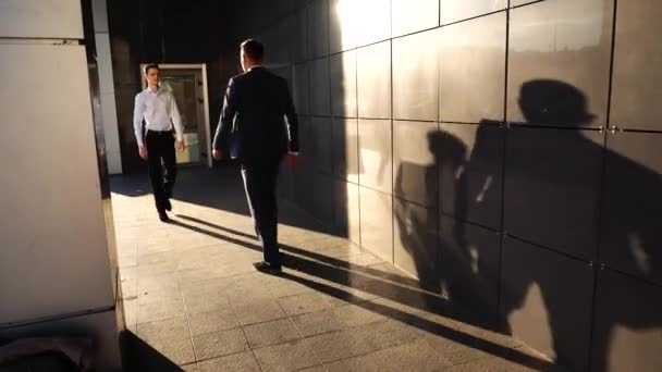 Business Team Walking With Shadows Shake Hands Near Center Office