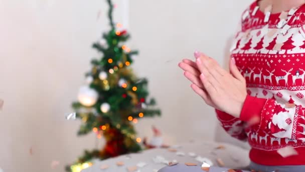 Young Girl Clap Hands on Bokeh Xmas Eve Lights New Year Tree Confetti Christmas