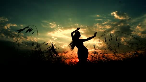 Silhouette Against Green-Yellow Sunset of One Young Graceful Girl Practicing Yoga Outdoors.