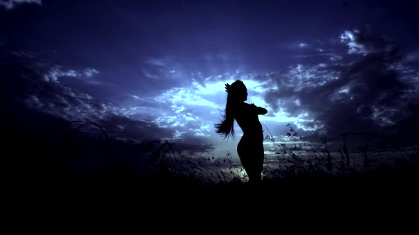 Moon Blue Color. Silhouette Against Sunset of One Young Graceful Girl Practicing Yoga Outdoors.