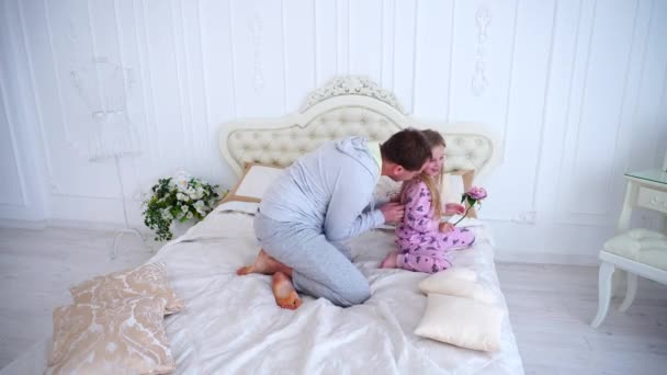 Dad Tickles Daughter, Played With Girl on Bed at Home