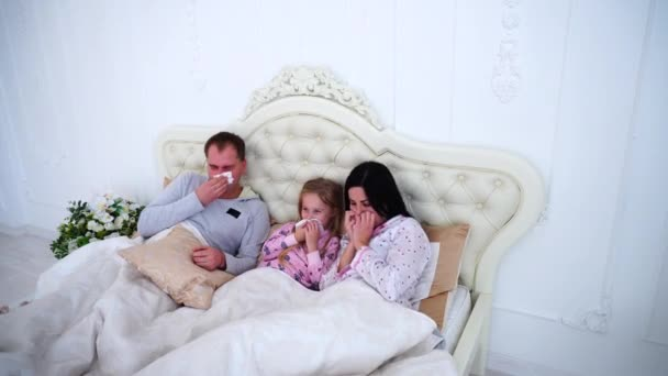 Young Family Got Sick or Ill Sneezing in Bed at Home