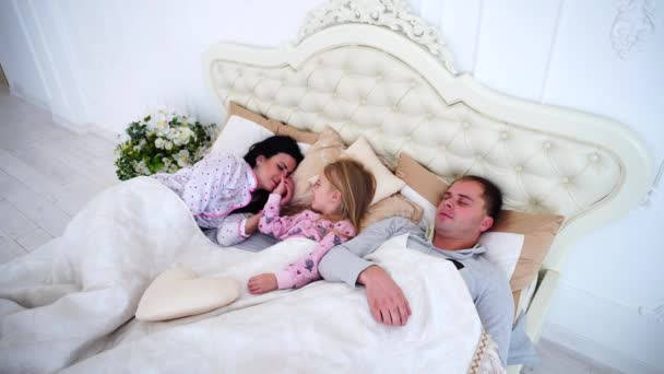 Little Daughter Wakes Parents in Bed Early Morning.