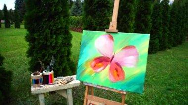 Festmények és művészeti elemek állnak festőállvány és szabadban Park táblázat részletei