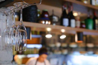 Glasses hanging upside down in cafe restaurant wine
