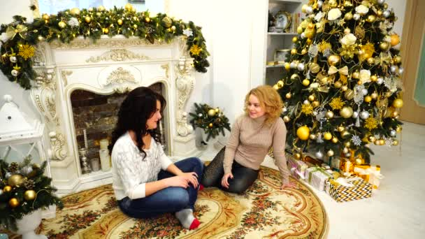 Merry girls have fun laughing and are sitting on floor in bright living room with festive fireplace decorated with festive fire and high Christmas winter ...  sc 1 st  Depositphotos & Merry girls have fun laughing and are sitting on floor in bright ...