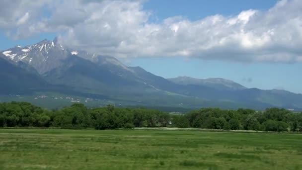 Tourist filming mountains out of bus window in Tatra Mountains range in Europe.