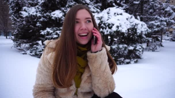 Beautiful young woman talking on phone.