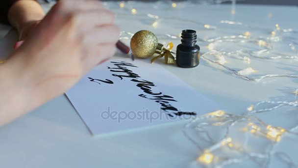 Written calligraphy inscription Happy New Year 2018.