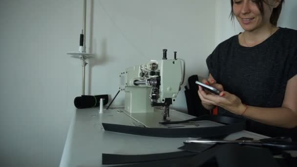 Slow motion craftswoman searching for ideas in internet using smartphone