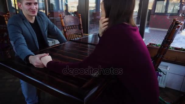 Boyfriend and girlfriend waiting for order in cafe and remembering first date.