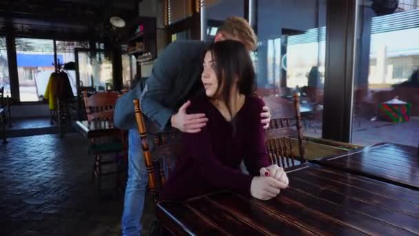 Brother surprising sister by unexpected appearance in luncheonette.