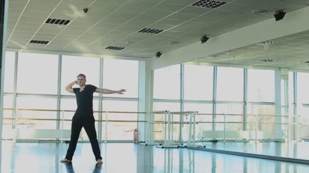 Hip hop dancer making different movements.
