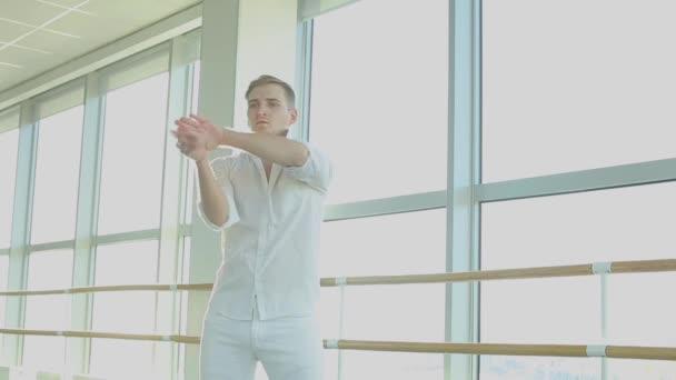 Street style dancer making hand movements near big window