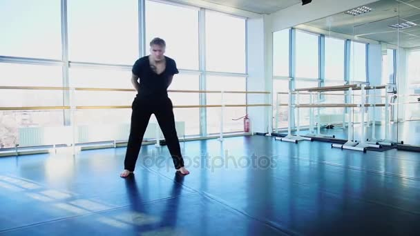 Dancer making aerobic warm up at studio.