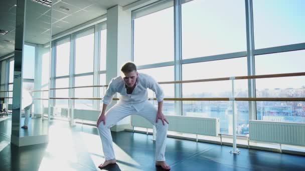 Dance school graduate making body movements.