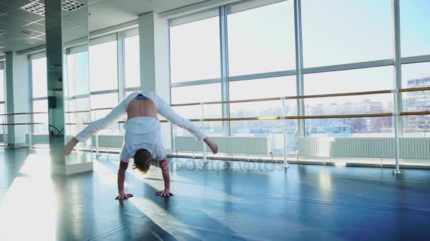 Dancer improving handstand with legs spread out