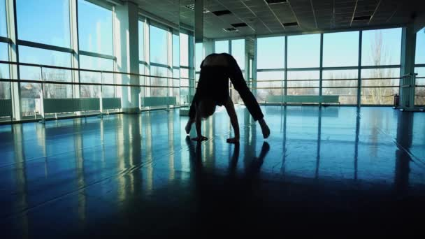 Acrobat in sportswear preparing for performance in hall.