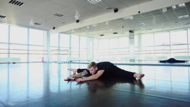 Programmer in sportswear doing gymnastics to avoid problems with back
