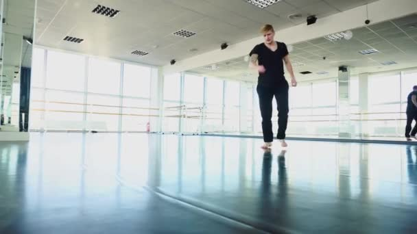 Ballroom dancer in sport clothes warming up before training