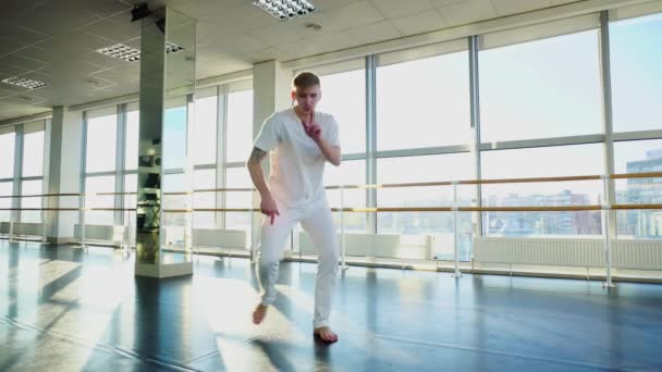 Economist in sportswear dancing and fooling for camera in gym
