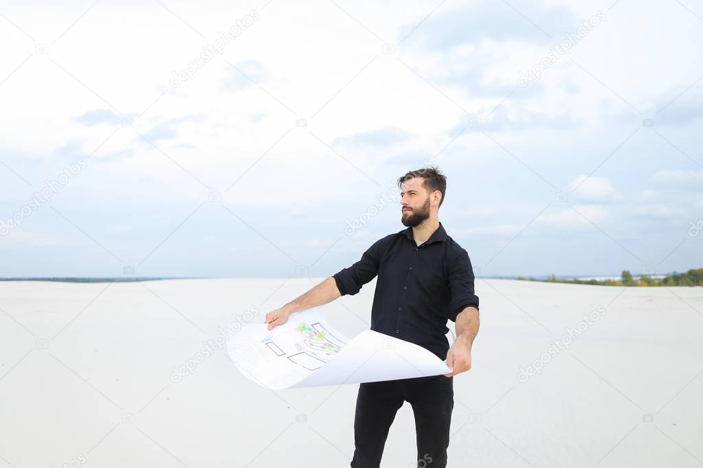 Archeologist man reviewing plan of excavations in village talk