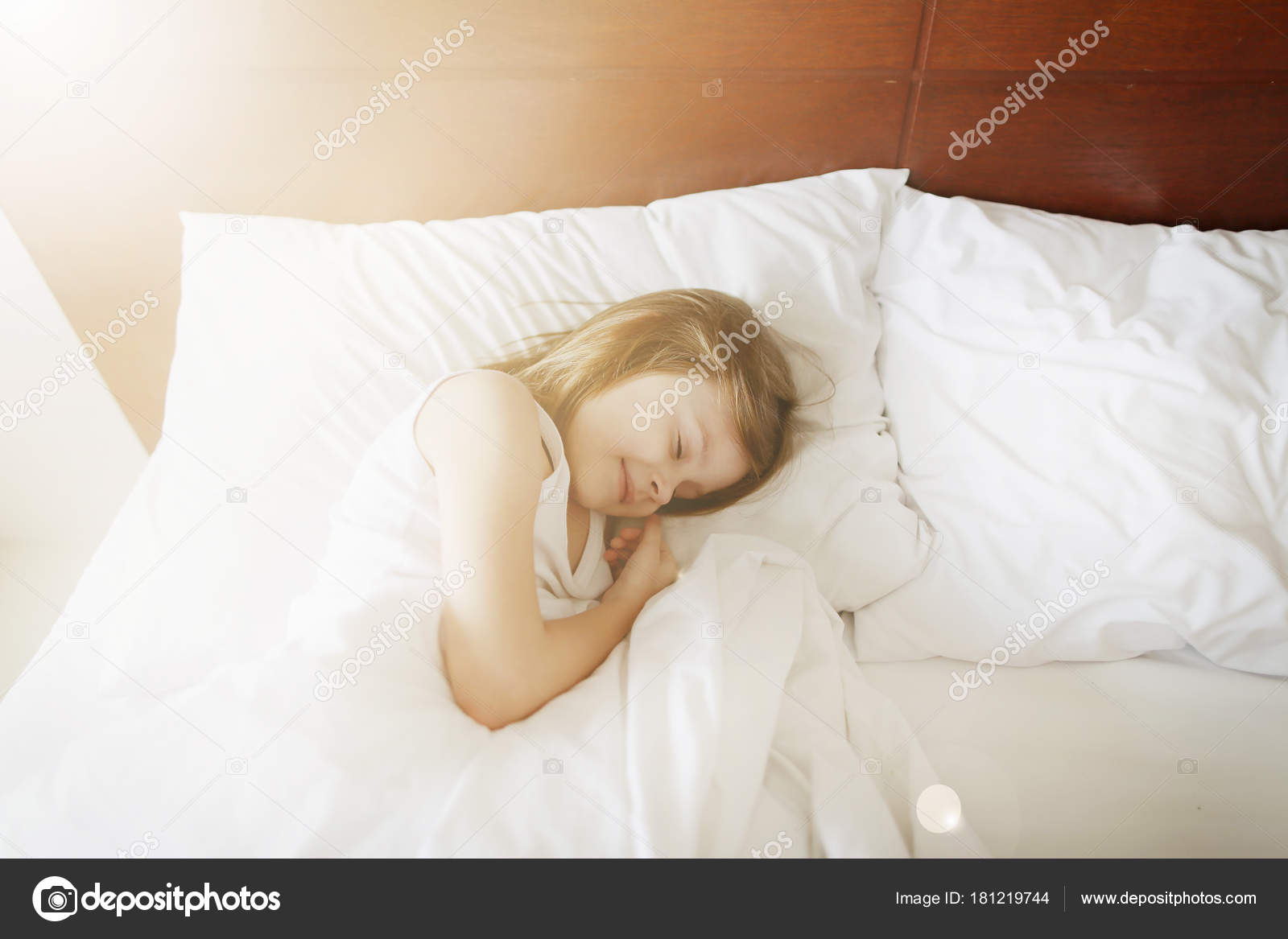 1aac00e8d Beauty sunshine portrait of sleeping kid girl at white bed. concept of  happy childhood