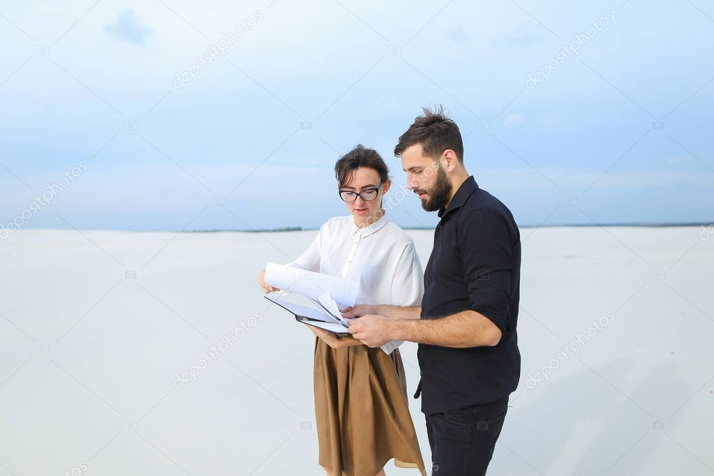 entrepreneurs male and female discussing project of beach ar
