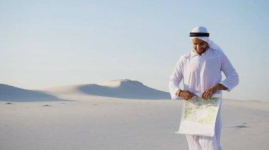 Male Emirati designer Arabian Sheikh completes site survey for c