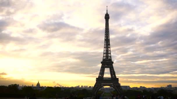 Concept of France attractions. Violet clouds and Paris landscape.