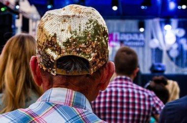 Senior man in a glamorous cap with rhinestones