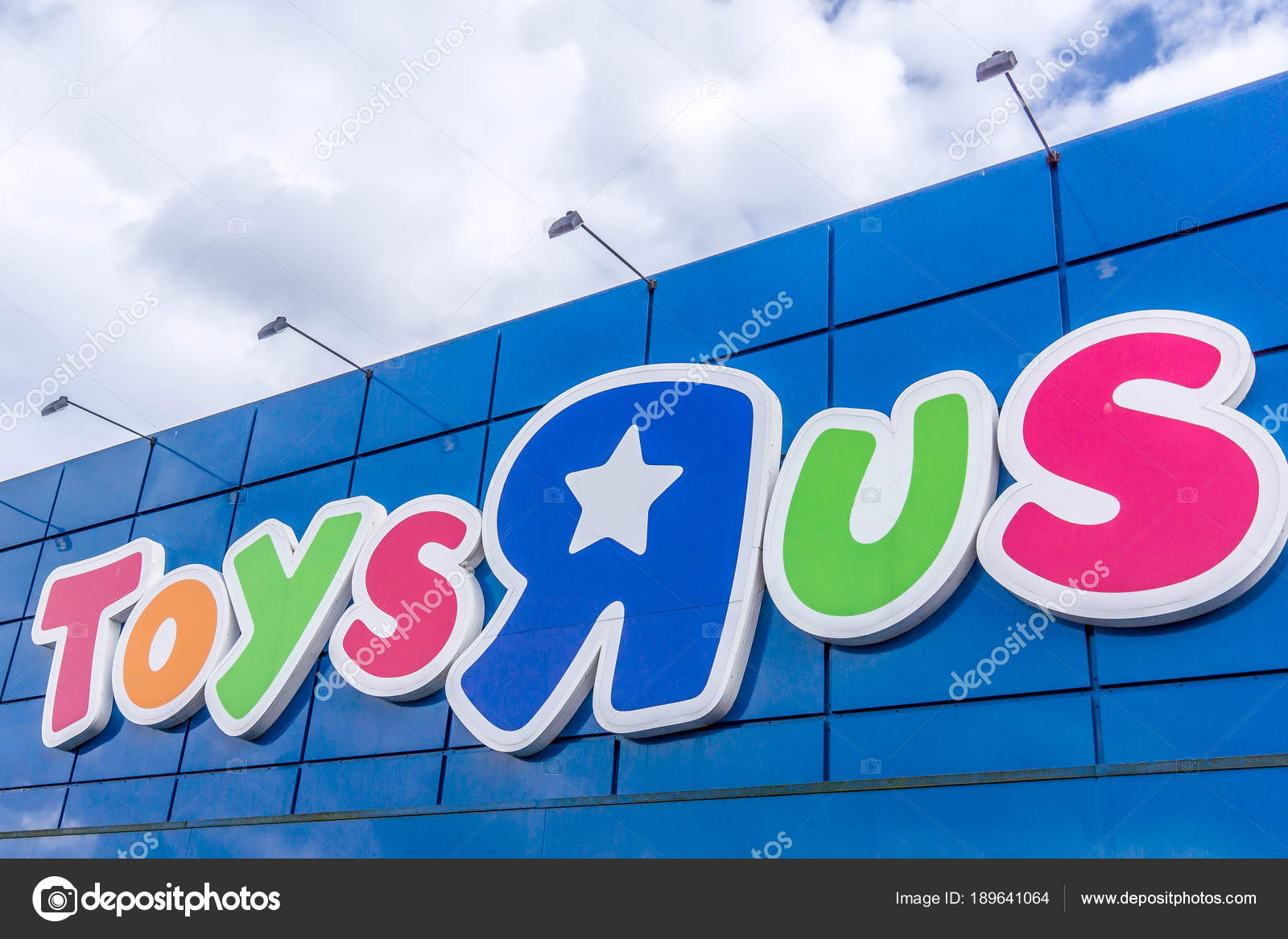 Sign Against Blue Sky Toysrus Is An American Toy Retailer Toys R