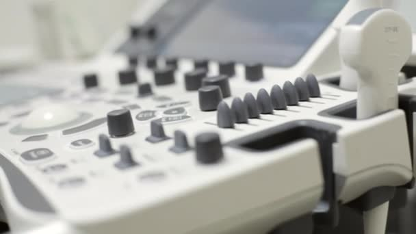 Ultrasound keyboard closeup, hands of doctor clicks on the button.