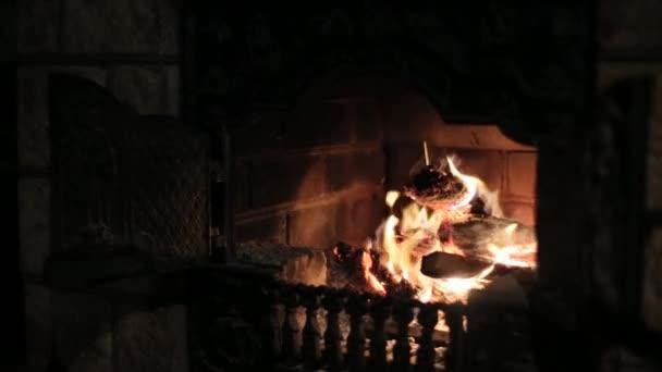 Burning fireplace making coziness at house