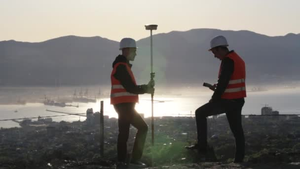 Two surveyors working on the ground since early morning