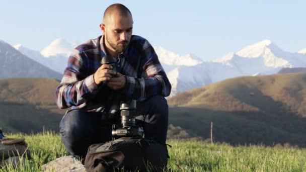 Fotós ül és a változó szakmai kültéri kamera objektívek.