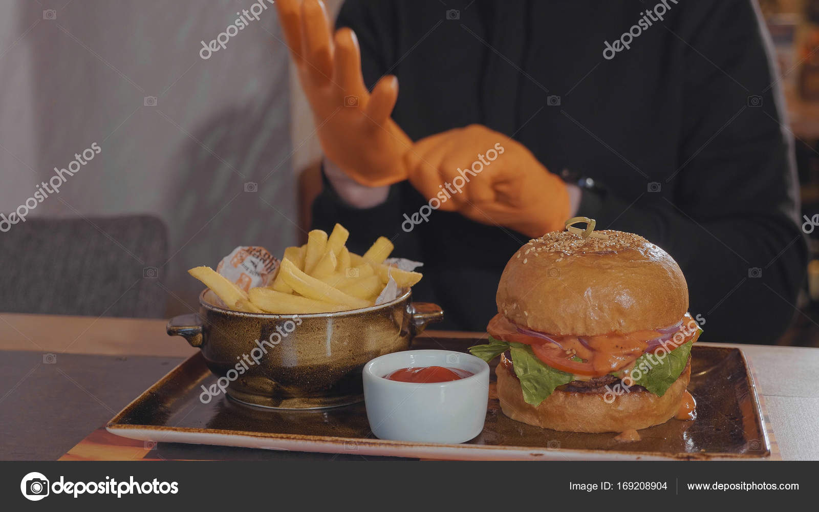 Man preparing for eating burger and french fries at fast