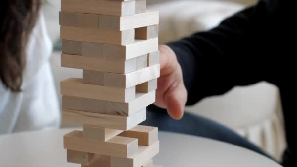 Family is playing in wooden tower at home