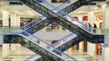 Amazing geometry of escalators at the mall. Customer traffic and buyers flow.