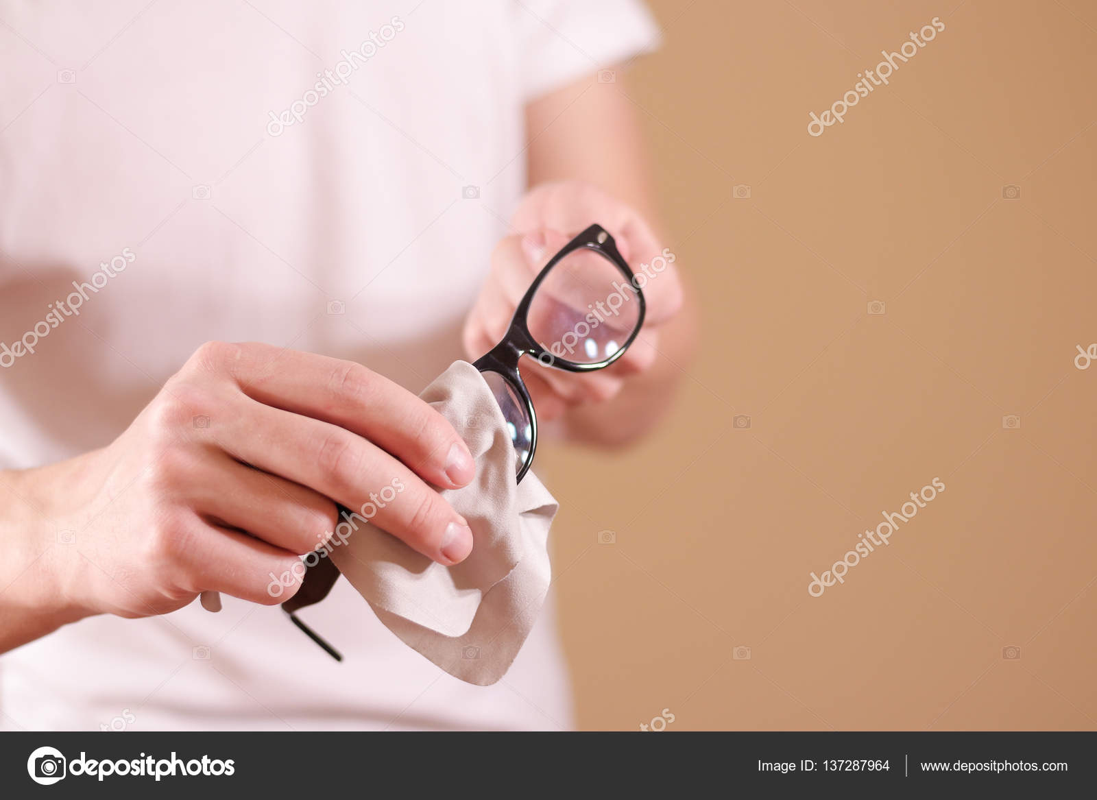 Man hand cleaning glasses lens with isolated background — Stock ...