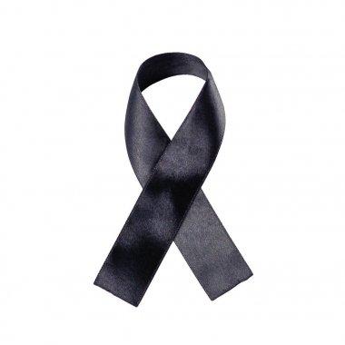 Black ribbon on a white background. Folded ribbon. Close up
