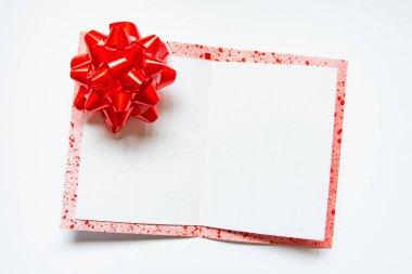 Handmade card opened on white background