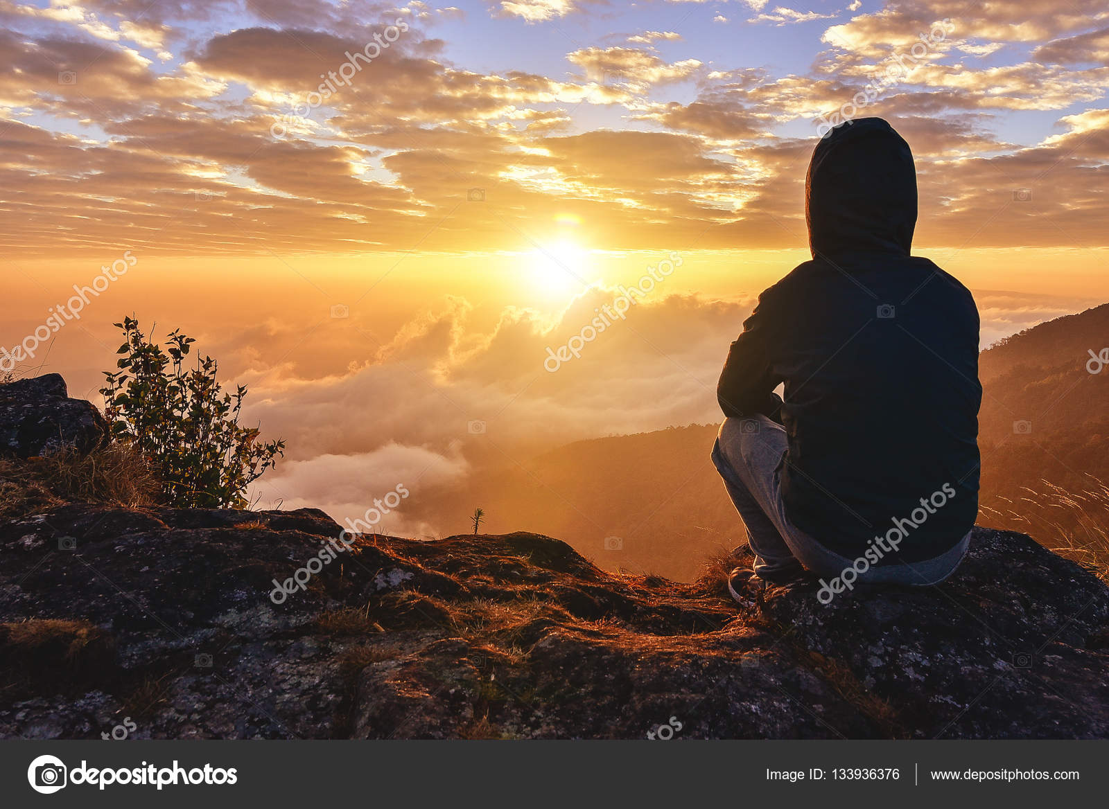 Lonely Man Sitting On A Mountain For Watching Sunrise Views Alone Stock Photo By C Theerapong28 133936376 Alone man loneliness nature clouds rocks