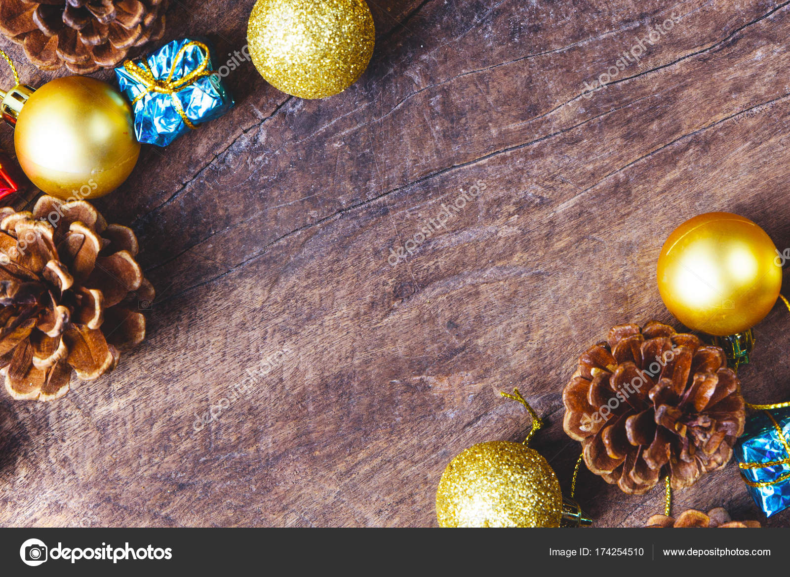 christmas or new year background with pine conesgift boxgolden ball of xmas decorations and fir branches flat lay blank space for a greeting text on